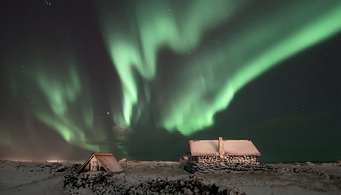 aurora-borealis-over-cabins-in-iceland