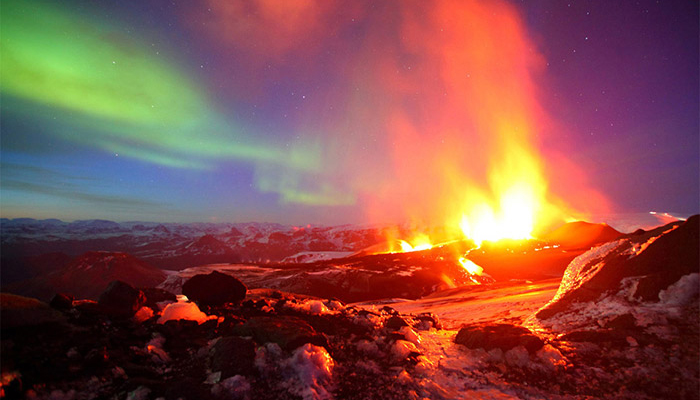 erupting-volcano-with-northern-light-iceland